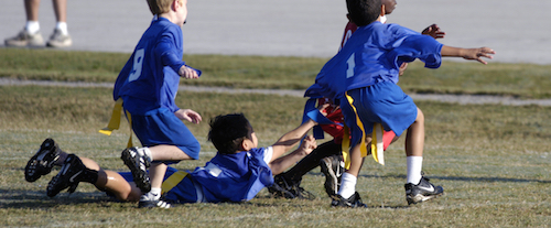 flag football players making a tackle