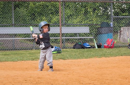 a youth baseball player batting