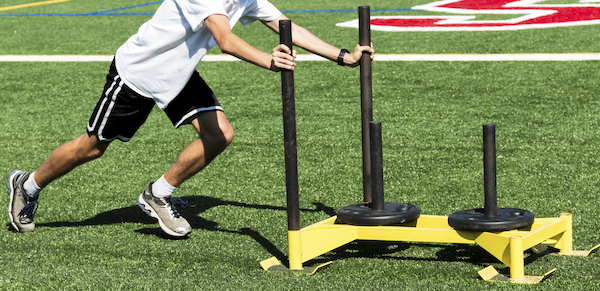 a football player doing conditioning drills